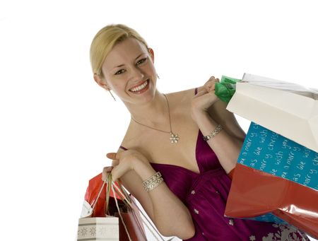 Glowing young blonde laden with shopping bags photo