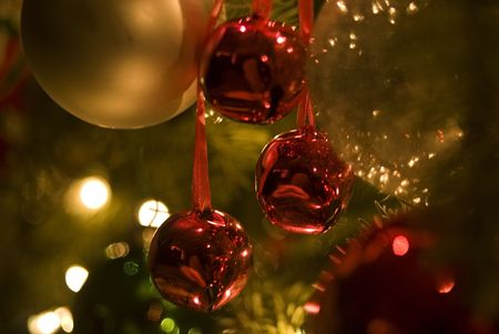 xmas background: Soft Focus close-up of colorful ornaments, bells and lights on Christmas Tree. Stock Photo