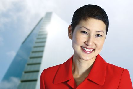 Beautiful Asian Businesswoman in Power Red. photo