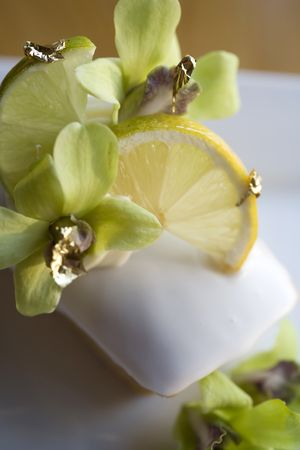 epicurean: Financiers or Friands and Meringue with Orchids.  Stock Photo