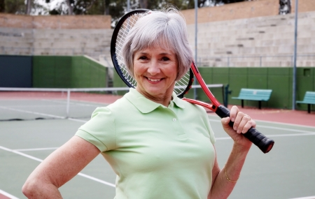 grannies: Active senior on the tennis court. Stock Photo