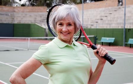 Active senior on the tennis court. Stock Photo