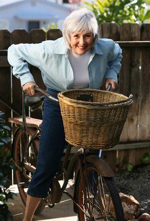 Baby Boomer Grandma ready for a heart-healthy ride. Stock Photo
