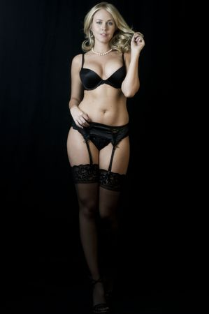 Seductive Blonde Stripper down to her lingerie.