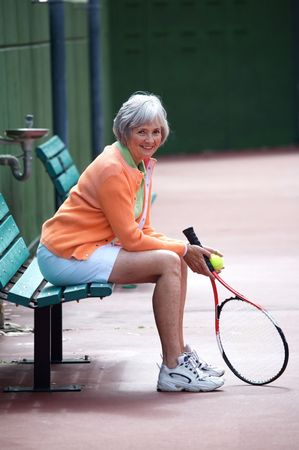 Active senior on the tennis court. Stock Photo
