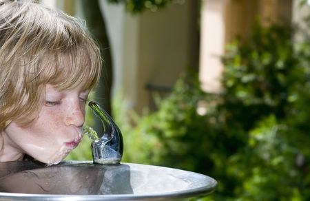 water activity: Little Girl (or Boy) slurping at the Drinking Fountain