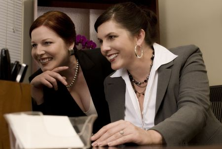 problemsolving: Two Problem-Solving Corporate Co-Workers Stock Photo
