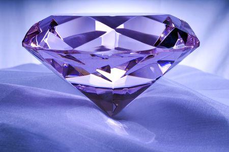 Diamond or Amethyst on Satin. Stock Photo