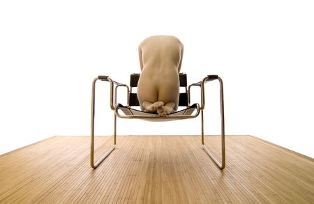 Beautiful Asian Nude abstractly posed on a Mid-Century Modern Chair.   photo