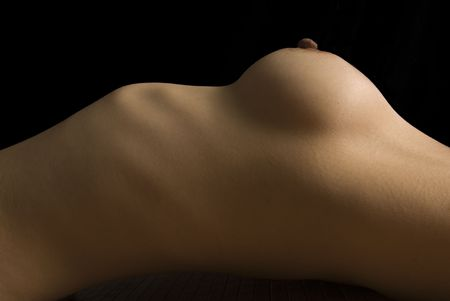 Topless torso reclined on bamboo mat.   photo