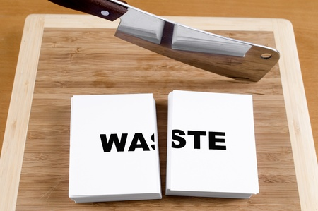 Cutting Waste with a Cleaver and Cutting Board. Stock Photo - 9082660