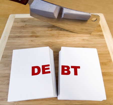 Cutting debt with a cleaver and cutting board. photo