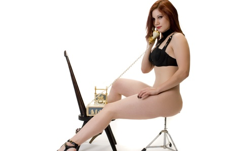 Stunning Redhead in On the Phone in Fetish Wear. photo