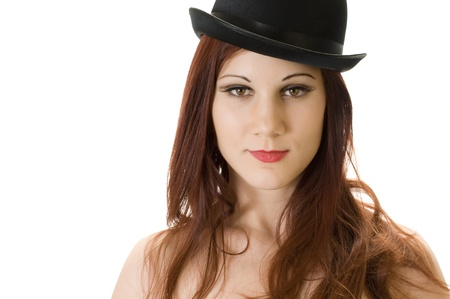 Head and Shoulders of Beautiful Irish or English Redhead Model with flawless complexion and a Bowler Hat. photo
