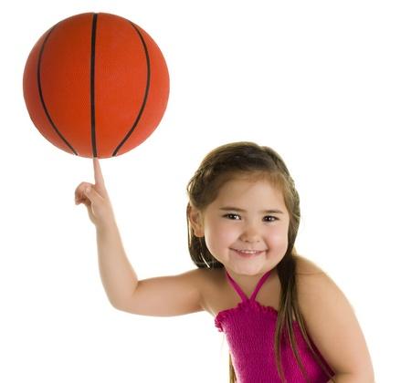 Adorable Pre-Schooler Balancing a Basketball on one Finger.