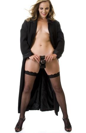 Sexy Fashion Model with Antique Folding Camera. Stock Photo - 9082774