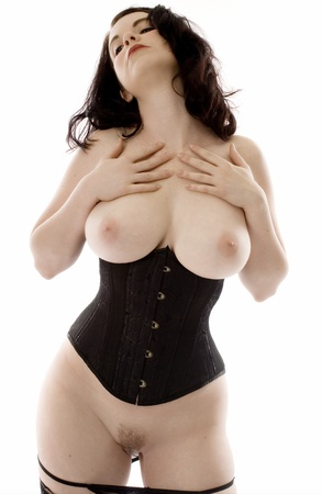 Voluptuous brunette in corset and stockings. Stock Photo