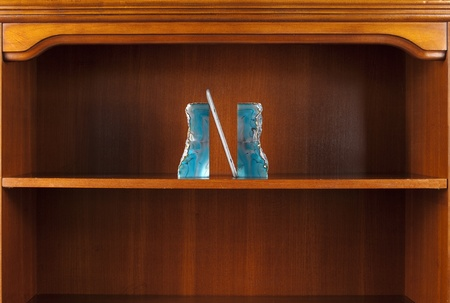 E-book on empty bookcase between bookends. photo