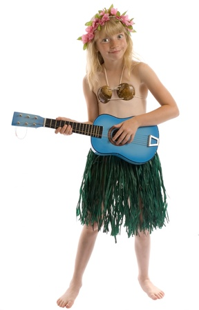 Little girl playing guitar or ukelele and hula dancing