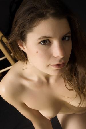 Topless portrait of a beautiful brunette
