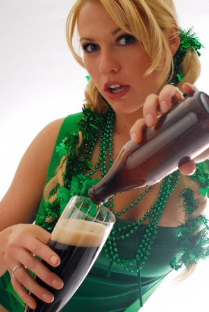 Beautiful Irish Lass Pouring a Pint of Ale  photo