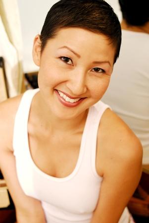 Headshot smiling Asian model in wife-beater shirt  photo