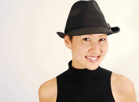 Beautiful Asian model in fedora