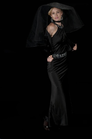 High fashion model in black satin cocktail gown.