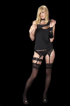 High fashion model in black lingerie removing her glove.
