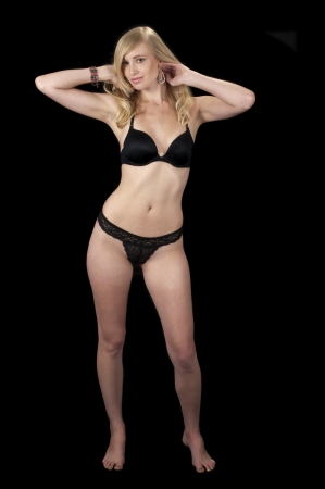 The Evening Wear Striptease Sequence: High fashion model posing in black lingerie.