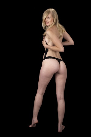 The Evening Wear Striptease Sequence: High fashion model in black lingerie removing her bra.