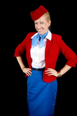 Retro Airline Attendant Isolated on Black. photo