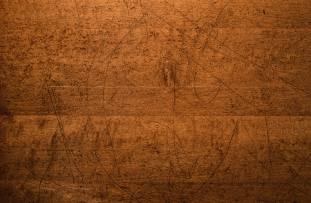 Overhead shot of the intricately distressed top of an old wooden table.   photo