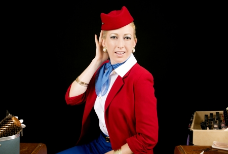 table skirt: Retro Airline Stewardess or Attendant Primping at her Vanity. Stock Photo