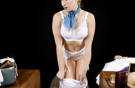 garter: Retro airline hostess removing her satin slip.