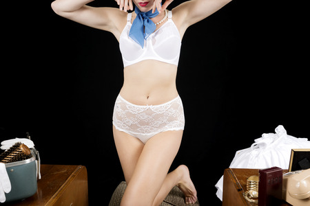 an attendant: Sexy Retro Airline Stewardess or Flight Attendant in Lingerie. Stock Photo