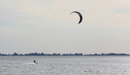 kite surfing: Kite surfing in the evening with back-lighting