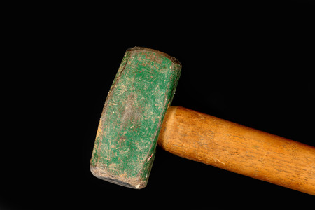 pounding head: Closeup of one green mallet head and wooden handle