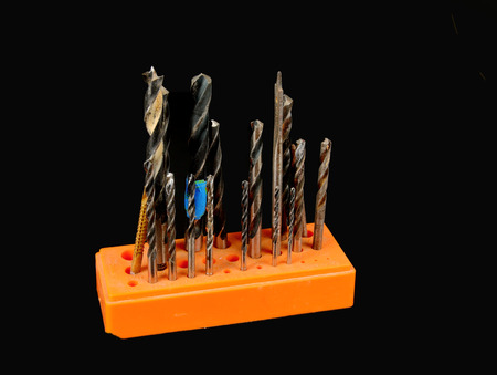Drill bits stored in an orange rack Stock Photo