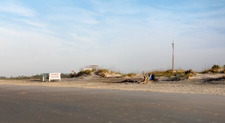 Early morning at the south end of Tybee Island beach. A view of the dunes on the south end of the island Stok Fotoğraf