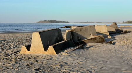 Concrete blocks used to form a breakwater at the south end of Tybee Island Georgia, stored on a beach.