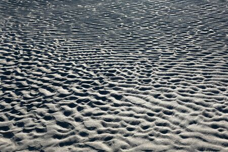 Pattern in the sand formed by waves and wind Banco de Imagens