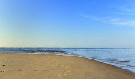 Early morning at the south end of Tybee Island beach with a view of the beach and the Atlantic Ocean