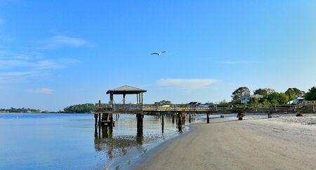 Early morning at the south end of Tybee Island beach. A view of the Tybee Creek side of the island