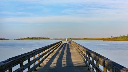 Early morning at the south end of Tybee Island beach. A view of the Back River Fishing Pier