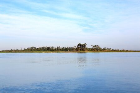 Early morning at the south end of Tybee Island beach with a view of Little Tybee Island across Tybee Creek Stock Photo