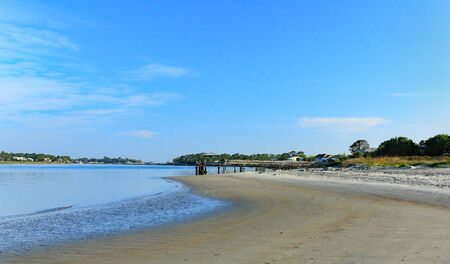 Early morning at the south end of Tybee Island beach. A view of the shoreline on the creek side of the island.