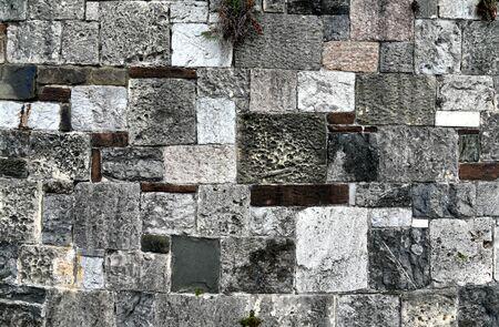 Close-up of a stone wall near River Street in Savannah, Georgia