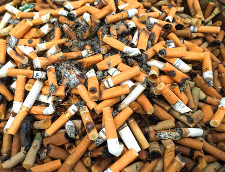 public waste: Cigarette Butts Background Editorial