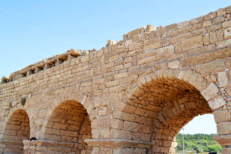 caesarea: Ancient Roman Aqueduct in Caesarea Stock Photo